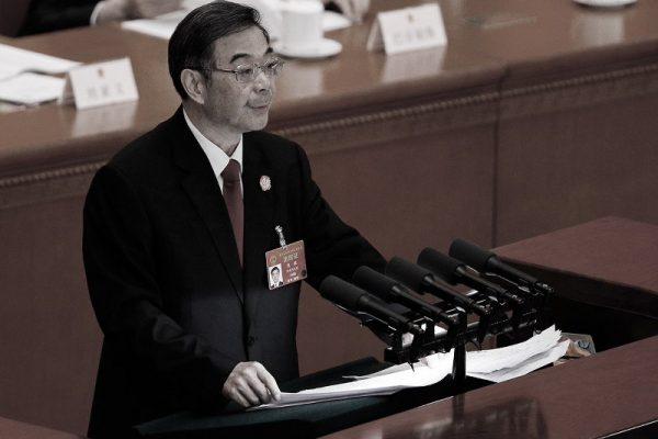 中共最高法院院长周强在3月12日的全国人大会议上做报告。(美联社)