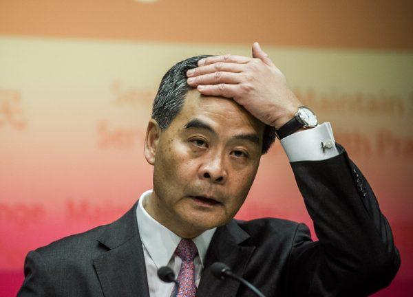 评论指梁振英弃选不突然 习正重新布局香港