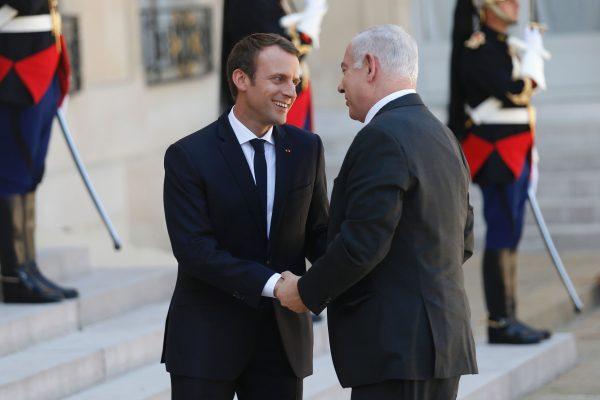 7月16日,马克龙和内塔尼亚胡出席巴黎的反大屠杀集会。(网络图片)