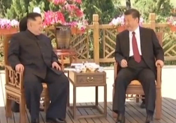 金正恩第二次访华时与习近平会晤(视频截图)