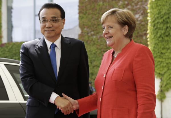 李克强在德国与默克尔会面。(美联社)