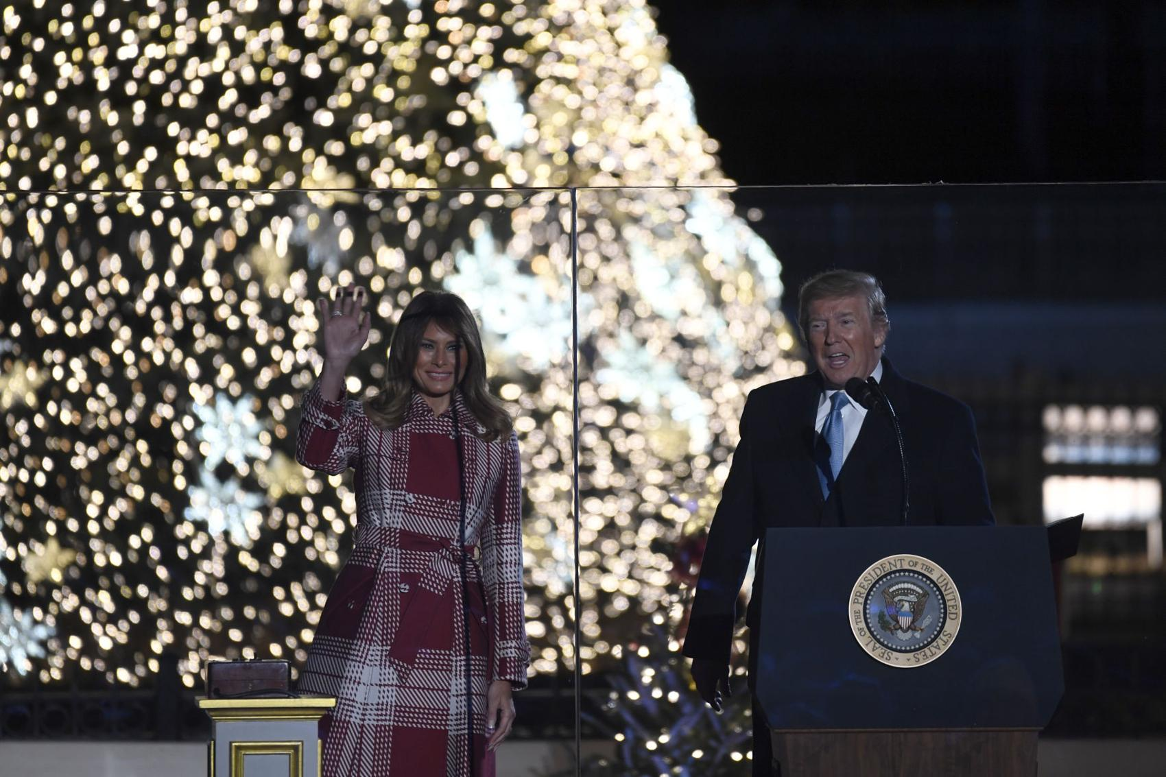 President Donald Trump and first lady Melania Trump light the National Christmas tree, Thursday, Dec. 5, 2019, in Washington. (AP Photo/Susan Walsh)