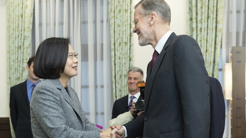 In this photo released by the Taiwan Presidential Office, William Brent Christensen, director of the American Institute in Taiwan at right meets with Taiwan President Tsai Ing-wen, at left in the Presidential Office in Taipei, Taiwan.