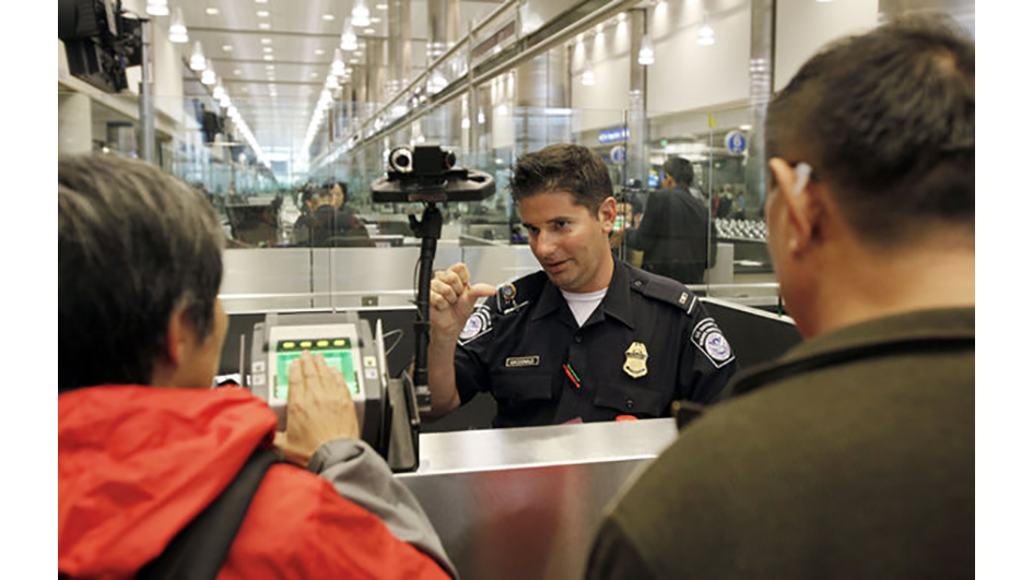US immigration fingerprint_custom(AP/Reed Saxon)