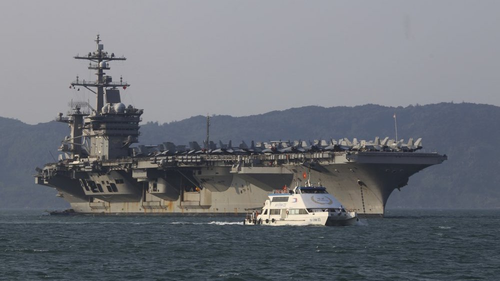 In this March 5, 2018, file photo, a Vietnamese passenger boat sails past U.S. aircraft carrier USS Carl Vinson as it docks in Danang bay, Vietnam. (AP Photo/Hau Dinh, File) (AP Photo/Hau Dinh, File)