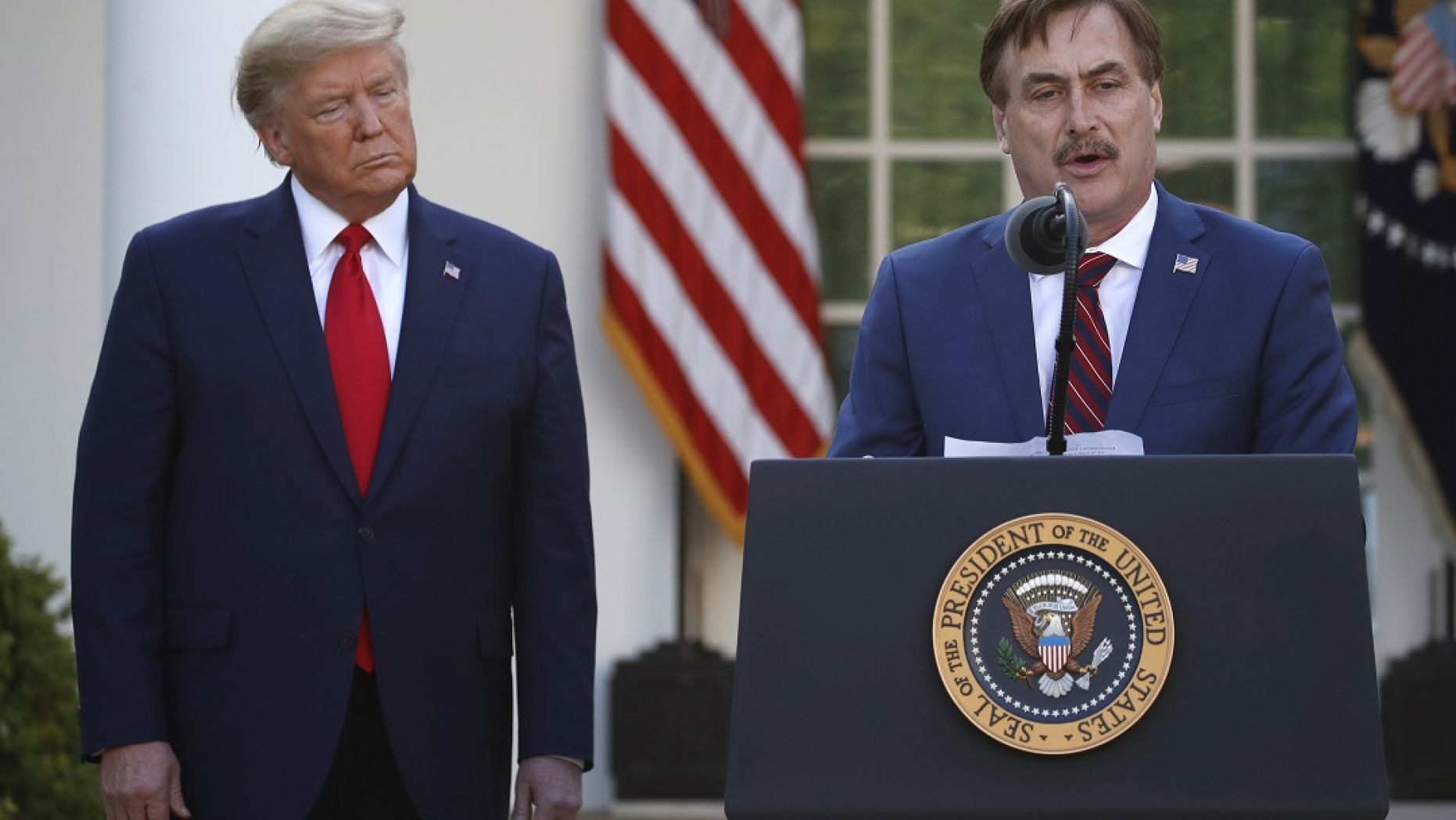 My Pillow CEO Mike Lindell speaks as President Donald Trump listens during a briefing about the coronavirus in the Rose Garden of the White House on Monday. (AP Photo/Alex Brandon)