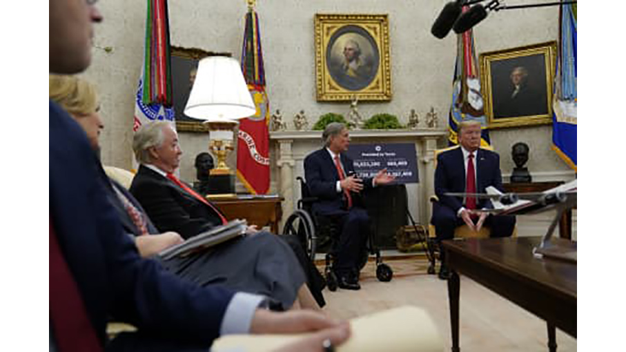 Trump listens as Texas Gov. Greg Abbott speaks in a meeting about virus in oval office on May 7 2020(AP Photo-Evan Vucci)