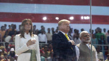 "U.S. President Donald Trump, first lady Melania Trump and Indian Prime Minister Narendra Modi stand during the national anthem during a ""Namaste Trump,"" event at Sardar Patel Gujarat Stadium, Monday, Feb. 24, 2020, in Ahmedabad, India. (AP Photo/Alex Brandon)"